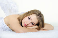 The young beautiful girl an angel with wings. On a white background Royalty Free Stock Image