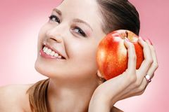 Young beautiful girl with apple Royalty Free Stock Photography