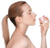 Young beautiful girl applying cream Royalty Free Stock Photography