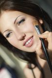 Young beautiful girl applying makeup Royalty Free Stock Photo