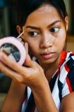 Young beautiful girl applying makeup. Girl coloring eyebrows with eyebrow liner Royalty Free Stock Photos