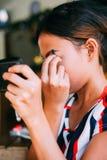 Young beautiful girl applying makeup. Girl coloring eyebrows with eyebrow liner Stock Image