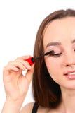 Young beautiful girl applying mascara Stock Photo