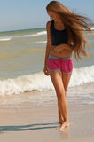 Young beautiful girl athlete  on the beach Stock Image