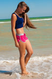 Young beautiful girl athlete  on the beach Stock Photos