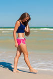 Young beautiful girl athlete  on the beach Royalty Free Stock Images