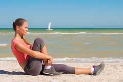 Young beautiful girl athlete playing sports on the beach Royalty Free Stock Images