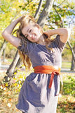 The young beautiful girl in autumn wood. On the sun Royalty Free Stock Photography