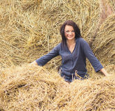 Young beautiful girl on a background of haystack Royalty Free Stock Photo