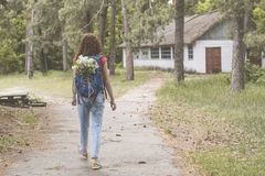 Young beautiful girl with backpack lost at the territory of abandoned summer kids camp. Young beautiful girl with backpack lost at the territory of abandoned royalty free stock photo