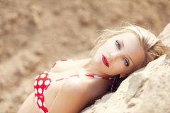 Young beautiful girl in a bathing suit. On sand Royalty Free Stock Photo