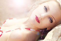 Young beautiful girl in a bathing suit. On sand Stock Images