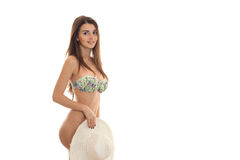 Young beautiful girl in a bathing suit and holding a hat Stock Photography