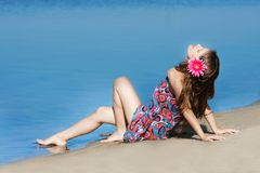 Young beautiful girl on beach Stock Image