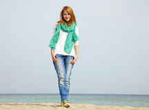 Young beautiful girl at the beach. Royalty Free Stock Images
