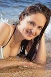 Young beautiful girl on the beach in a bikini Stock Photos