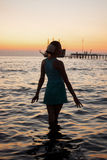 Young beautiful girl on the beach looking out to sea Stock Photography