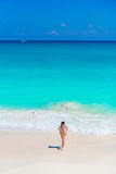 Young beautiful girl on the beach at shallow tropical water top view Stock Photos