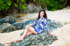 Young beautiful girl on the beach of a tropical island. Summer v Royalty Free Stock Photo