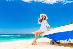 Young beautiful girl on the beach of a tropical island. Summer v Royalty Free Stock Photography