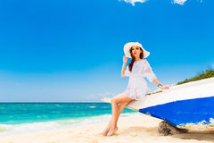 Young beautiful girl on the beach of a tropical island. Summer v Royalty Free Stock Images