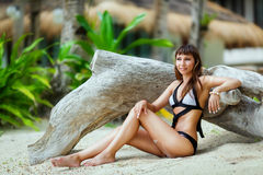 Young beautiful girl on the beach of a tropical island. Summer v Royalty Free Stock Photos