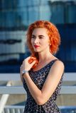 Young beautiful girl with beautiful appearance. Red-haired woman with a pretty face at sunset. A charming, smiling woman portrait Stock Images