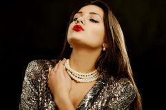 Young beautiful girl in beautiful jewelry Royalty Free Stock Photo