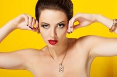 Young beautiful girl in beautiful jewelry Royalty Free Stock Image