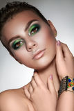 Young beautiful girl with beautiful makeup in green colors  and Royalty Free Stock Images