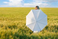 Young beautiful girl behind white umbrella Stock Images
