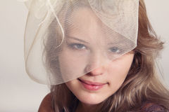 Young beautiful girl in beige veil Stock Photos