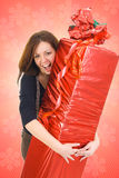 The young beautiful girl with the big gift Stock Photography