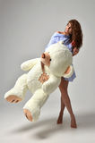 Young beautiful girl with big teddy bear soft toy happy smiling Stock Images
