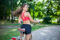 Young beautiful girl with bike Stock Photo