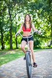Young beautiful girl with bike Royalty Free Stock Photography