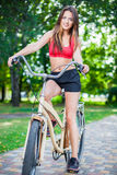 Young beautiful girl with bike Royalty Free Stock Images