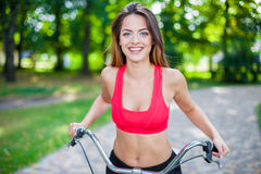 Young beautiful girl with bike Stock Photos