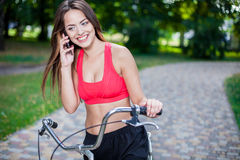 Young beautiful girl with bike Royalty Free Stock Image