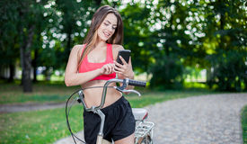 Young beautiful girl with bike Royalty Free Stock Photo