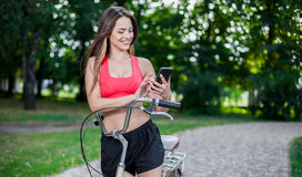 Young beautiful girl with bike Stock Images
