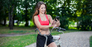 Young beautiful girl with bike Stock Photography