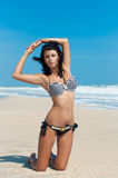Young beautiful girl in a bikini on a beach Stock Images