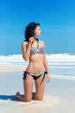 Young beautiful girl in a bikini on a beach Stock Image