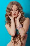 Young beautiful girl in a bikini in the studio Royalty Free Stock Photography