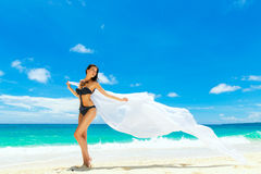 Young beautiful girl in bikini with white cloth on the beach of Stock Photos