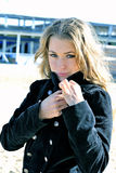 The young beautiful girl in a black coat. On a wind Royalty Free Stock Images