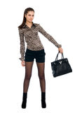 Young beautiful girl with a black handbag Stock Photo