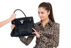 The young beautiful girl with a black handbag Stock Image