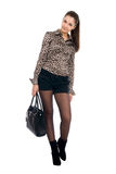 Young beautiful girl with a black handbag Stock Images